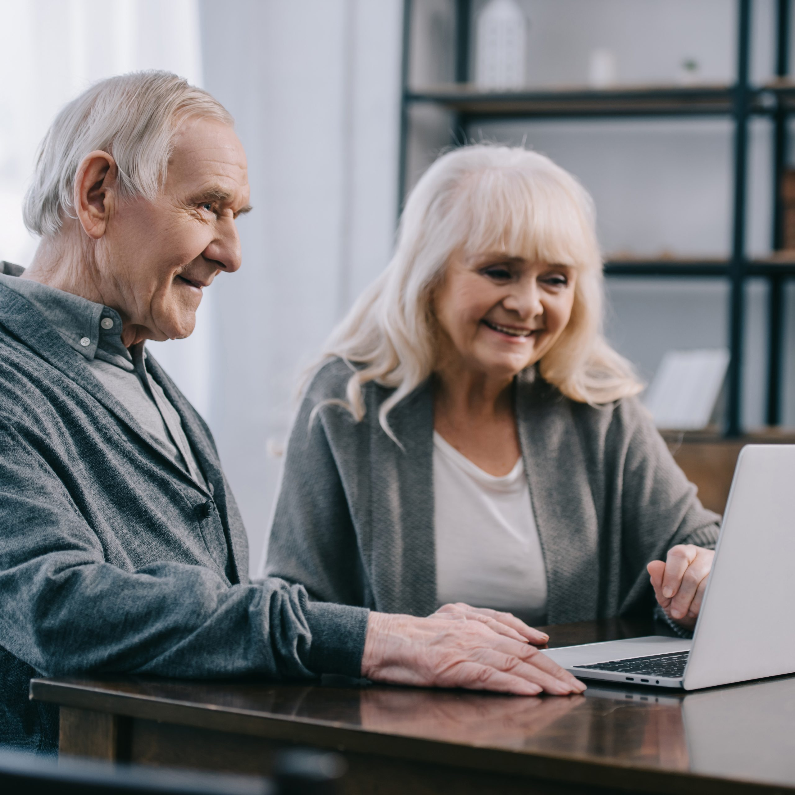 Couple smiling at their computer