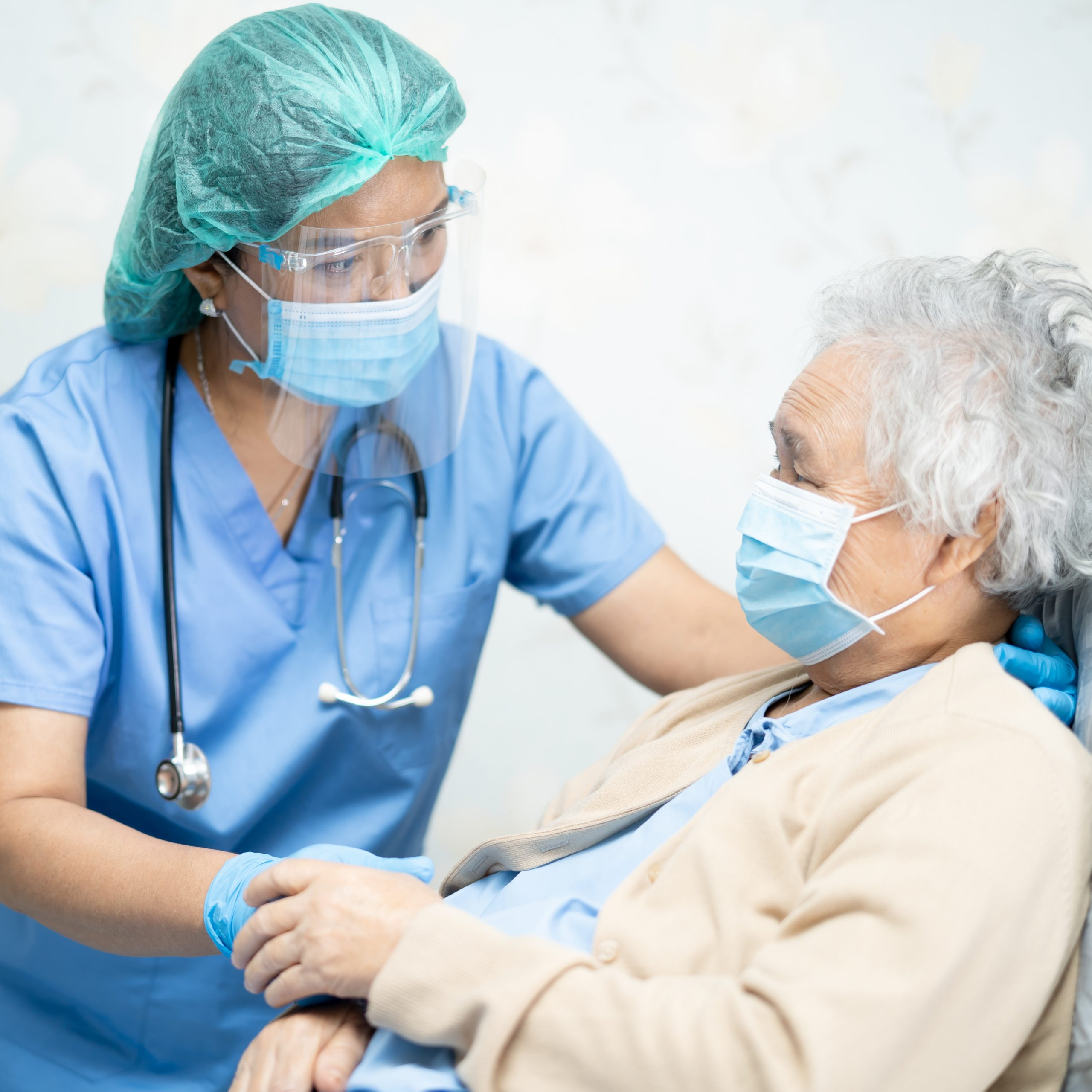 doctor helping elderly patient