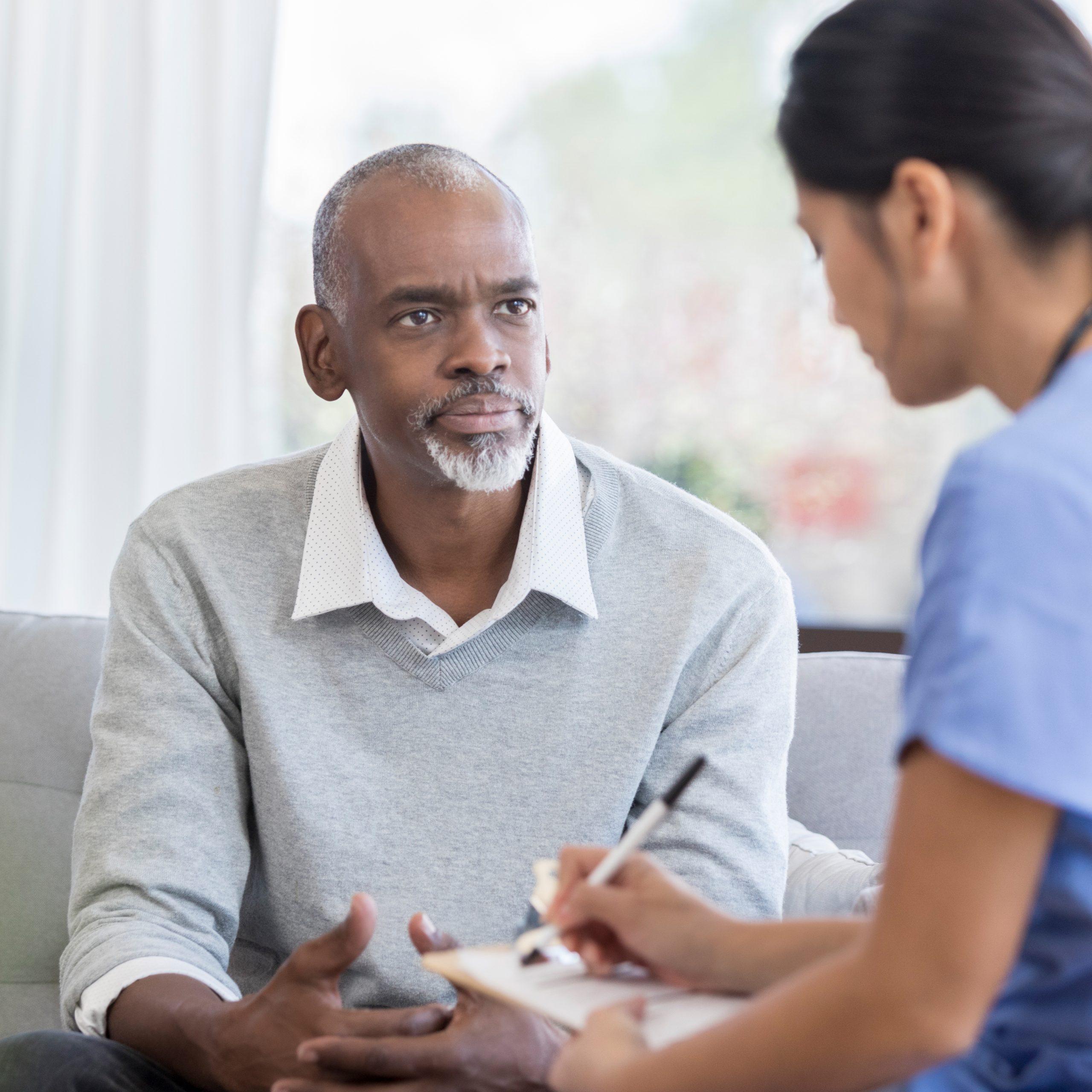 senior man talks with doctor