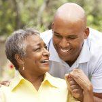 senior woman and adult son joyful